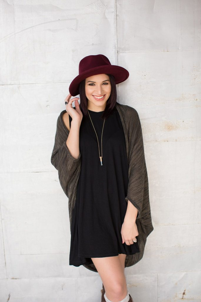 black piko dress brown boots hat