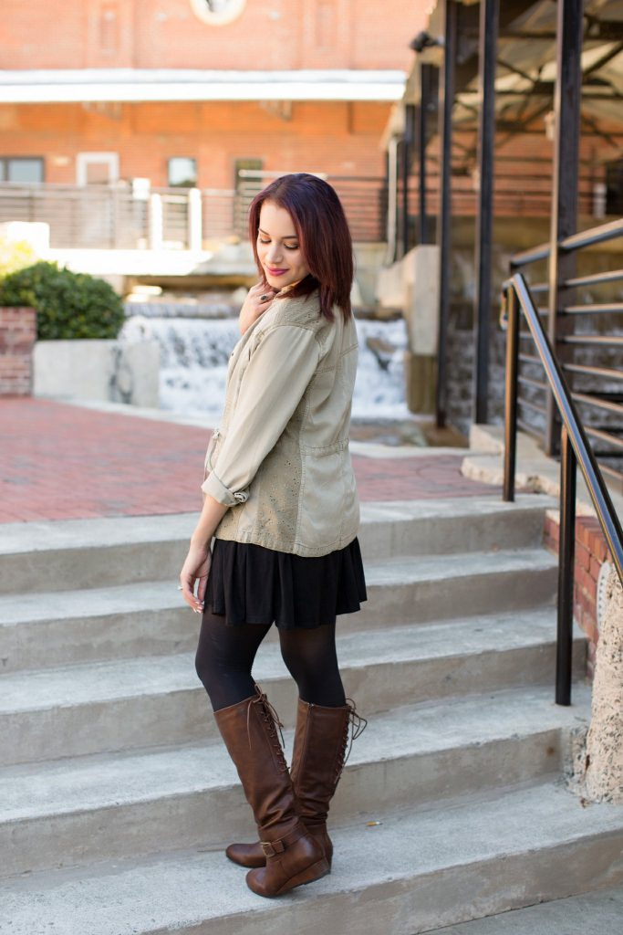 black piko dress utility jacket black tights brown riding boots rocksbox necklace