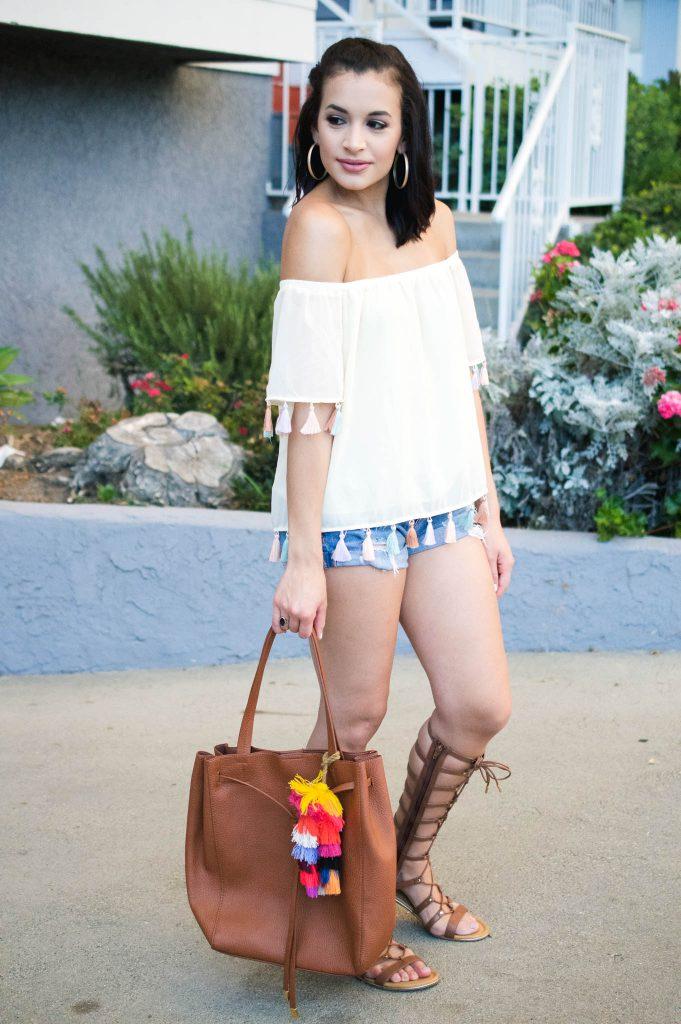 off the shoulder top, tassel top, outfit with tassels, denim shorts, express denim, gladiator sandals, dsw sandals, nordstrom sale, n sale, bp handbag, tassel charm, LA blogger, Los Angeles