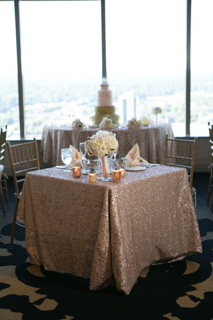 wedding decor, rose gold wedding, city club Raleigh, downtown Raleigh, floating candles, rose tablecloth, capitol club Raleigh, blush and gold themed wedding, sequin tablecloth, Steve Madden gold heels, open bar wedding, unplugged wedding ceremony, wedding bouquet, m & m wedding favors, halo engagement ring, rose gold themed wedding