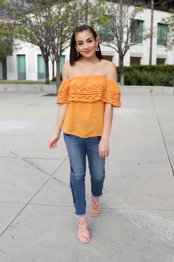 off the shoulder top, embroidered jeans