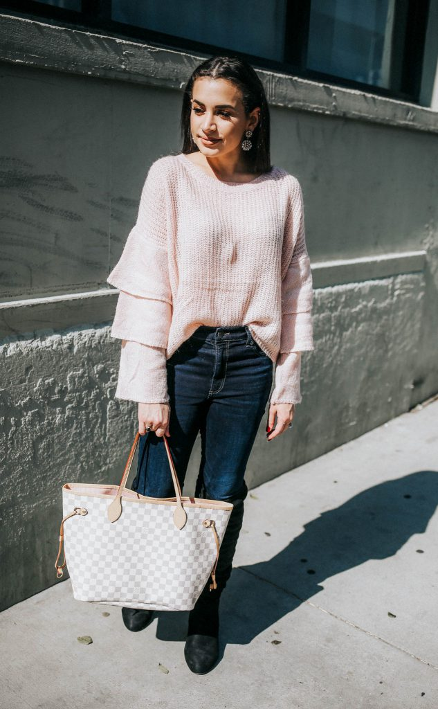 pink ruffled sweater